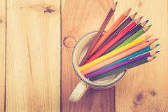 Color pencil on wood table background. Royalty Free Stock Image