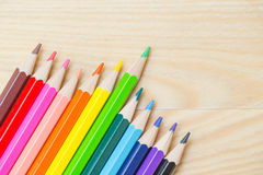 Color pencil on wood table background. Royalty Free Stock Images