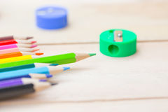 Color pencil on wood table background. Stock Image