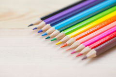 Color pencil on wood table background. Royalty Free Stock Photos