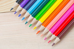 Color pencil on wood table background. Royalty Free Stock Photography