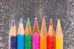 Color Pencils. Arrangement of color pencils fizzing in water Stock Image