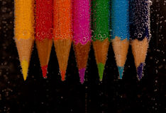 Color Pencils. Arrangement of color pencils fizzing in water Royalty Free Stock Photography