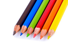 Color Pencils. Six color pencils laying in a line. Focus on a green pencil. Isolated on white Royalty Free Stock Photo