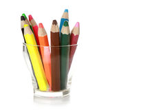 Color pencils. Color pencil in glass. On a white background royalty free stock photos