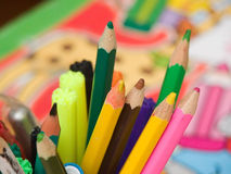 Color Pencils. Some coloured pencils. Decorated paper on the background Royalty Free Stock Images