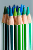 Color pencils. Green and blue color pencils Stock Images