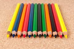 Color pencils. On a wooden board Stock Photos