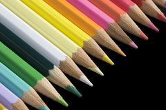 Color pencils. Background / wallpaper: color pencils over black background royalty free stock photo