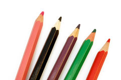 Color pencils. Pink, black, red, green, brown, on white background stock photos