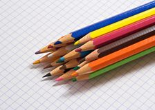 Color pencils. On a sheet of squared paper royalty free stock photos