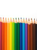 Color pencils. Aligned in a rainbow pattern on a white background royalty free stock photography