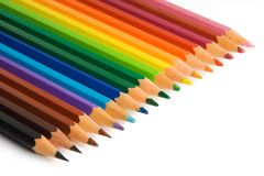 Color pencils. Aligned in a rainbow pattern on a white background royalty free stock photos