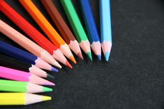 Color pencils. The color sharpened pencils on a black background Stock Photo