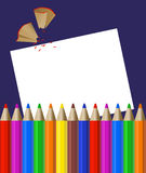 Color Pencils. Background with color pencils, shavings and blank paper stock illustration