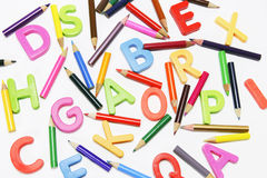 Color Pencils and Alphabets Stock Images