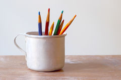 Color pencils in an aluminum mug Stock Photography