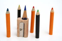 Color pencils around of a unusual sharpener. The set of small color pencils around of a unusual sharpener which stands vertically Stock Image