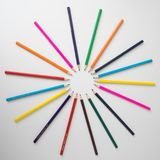 Color pencils in arrange in color wheel. Colors on white background Stock Photos