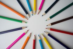 Color pencils in arrange in color wheel. Colors on white background Royalty Free Stock Images