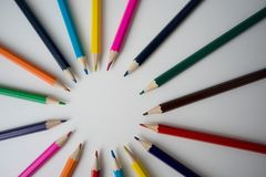 Color pencils in arrange in color wheel. Colors on white background Stock Photo