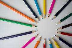 Color pencils in arrange in color wheel. Colors on white background Royalty Free Stock Photos