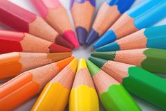 Color pencils in arrange in color wheel colors Royalty Free Stock Image