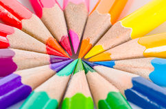 Color pencils in arrange in color wheel colors. Royalty Free Stock Photo