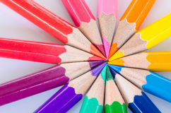 Color pencils in arrange in color wheel colors. Royalty Free Stock Image