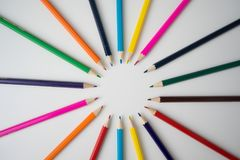 Color pencils in arrange in color wheel. Colors on white background Stock Images