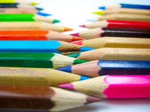 Color pencils in arrange with focus on middle. Color pencils in arrange with focus on the middle Stock Photo