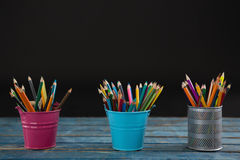 Color pencils arranged in pencil holder Royalty Free Stock Photography