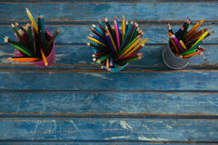 Color pencils arranged in pencil holder Royalty Free Stock Photos