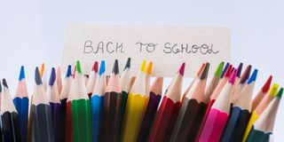 Color Pencils and back to school title Stock Photo