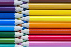 Color pencils background, zipper stylized. Warm and cold color royalty free stock photography