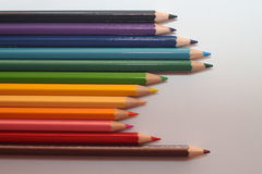 Color pencils being placed in order. Random colorful color pencils being placed in order Royalty Free Stock Photos