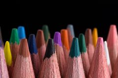 Color pencils on black background close up. stock photography