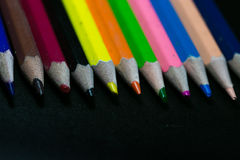 Color pencils on black background Royalty Free Stock Photos
