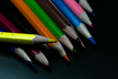 Color pencils on black background Stock Photos