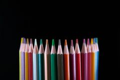 Color pencils on black background Stock Images