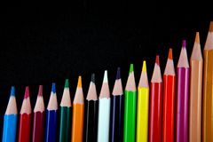 Color pencils on black background Royalty Free Stock Image