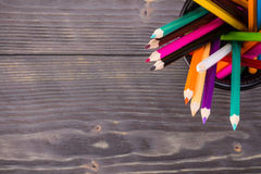 Color pencils in black office Stock Photography