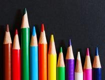 Color pencils on black paper Stock Image