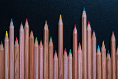Color pencils on black table Stock Photos