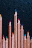 Color pencils on black table Stock Image