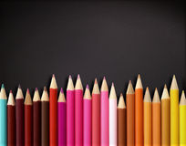 Color pencils on blackboard. Color pencils with blackboard design Royalty Free Stock Photos