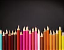 Color pencils on blackboard Royalty Free Stock Photos