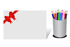 Color Pencils And Blank Paper with Red Ribbon Stock Image