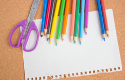 Color pencils, blank paper and scissors. Royalty Free Stock Photo