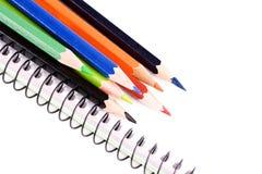 Color pencils on a blank sheet Stock Photos